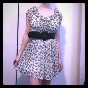 Off white chiffon dress with bow print.
